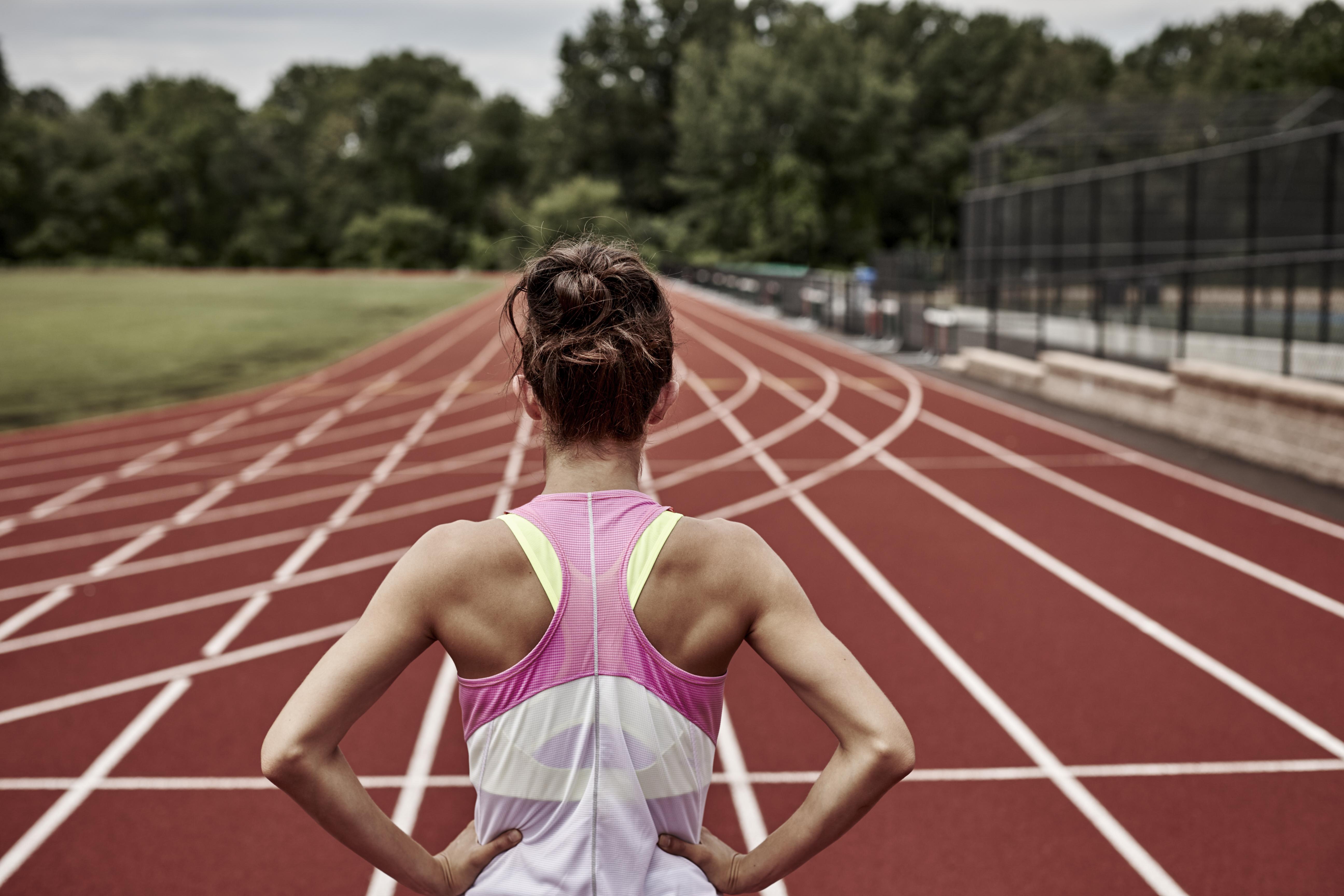 woman staring at track